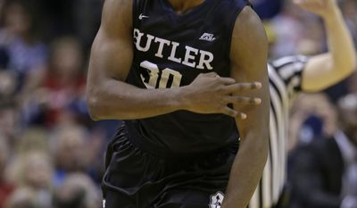 Butler forward Kelan Martin (30) celebrates a three-point basket against Indiana in the second half of an NCAA college basketball game in Indianapolis, Saturday, Dec. 17, 2016.(AP Photo/Michael Conroy)