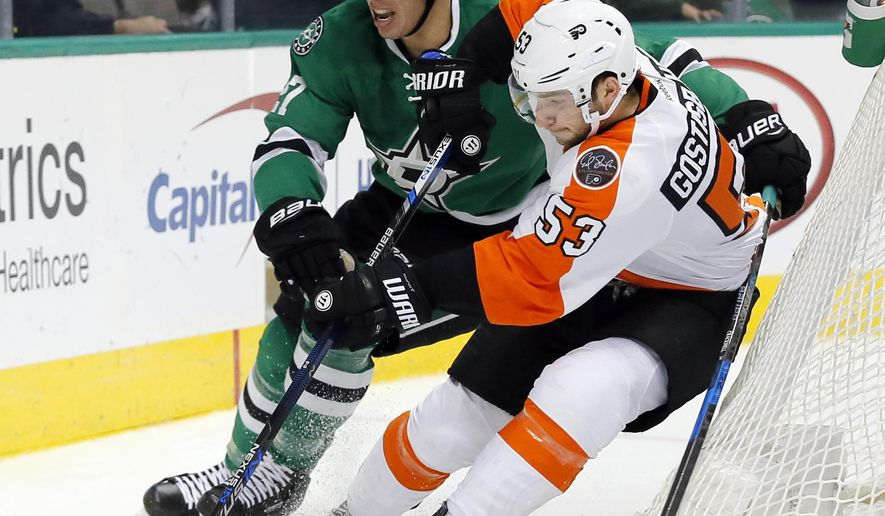 Dallas Stars right wing Adam Cracknell (27) challenges Philadelphia Flyers' Shayne Gostisbehere (53) for control of the puck in the first period of an NHL hockey game, Saturday, Dec. 17, 2016, in Dallas. (AP Photo/Tony Gutierrez)