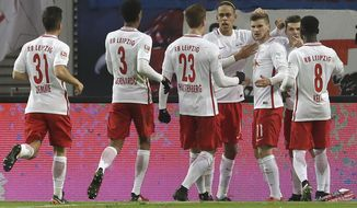Leipzig's scorer Timo Werner, 3rd right, and his teammates celebrate the opening goal during the German Bundesliga soccer match between RB Leipzig and Hertha BSC Berlin in Leipzig, Germany, Saturday, Dec. 17, 2016. (AP Photo/Michael Sohn)