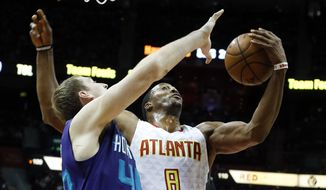 Atlanta Hawks center Dwight Howard (8) battles Charlotte Hornets center Cody Zeller (40) for a rebound in the first half of an NBA basketball game Saturday, Dec. 17, 2016, in Atlanta. (AP Photo/John Bazemore)