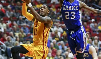 Iowa State guard Monte Morris shoots after driving past Drake guard Ore Arogundade during the first half of an NCAA college basketball game, Saturday, Dec. 17, 2016, in Des Moines, Iowa. (AP Photo/Justin Hayworth)