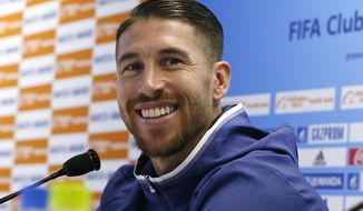 Real Madrid's Sergio Ramos smiles during a press conference at the FIFA Club World Cup soccer tournament in Yokohama, near Tokyo, Saturday, Dec. 17, 2016. Real Madrid and Japan's Kashima Antlers will play in Sunday's final. (AP Photo/Shuji Kajiyama)