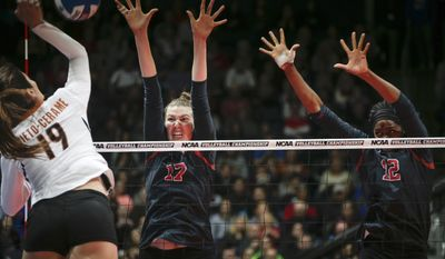 Stanford middle blocker Merete Lutz (17) rises for a block with teammate middle blocker Inky Ajanaku (12) on a shot from Texas outside hitter Paulina Prieto-Cerame (19) during the women's NCAA volleyball title game Saturday, Dec. 17, 2016, in Columbus, Ohio. (Joshua A. Bickel  /The Columbus Dispatch via AP)