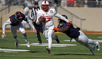 New Mexico quarterback Lamar Jordan, center, is sacked by UTSA safety Michael Egwuagu during the first half of the New Mexico Bowl NCAA college football game in Albuquerque, N.M., Saturday, Dec. 17, 2016. (AP Photo/Andres Leighton)