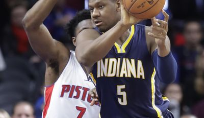 Indiana Pacers forward Lavoy Allen (5) passes the ball defended by Detroit Pistons forward Stanley Johnson (7) during the first half of an NBA basketball game, Saturday, Dec. 17, 2016 in Auburn Hills, Mich. (AP Photo/Carlos Osorio)