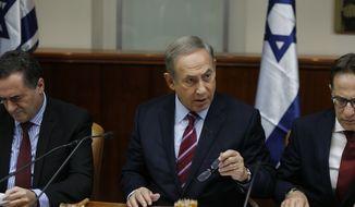 Israeli Prime Minister Benjamin Netanyahu, center, attends the weekly cabinet meeting in Jerusalem, Sunday, Dec. 18, 2016. (Amir Cohen, pool via AP)