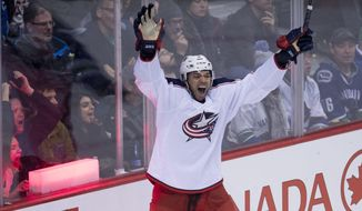Columbus Blue Jackets defenseman Seth Jones (3) celebrates his goal against the Vancouver Canucks in overtime of an NHL hockey game, Sunday, Dec. 18, 2016 in Vancouver, British Columbia. (Jonathan Hayward/The Canadian Press via AP)