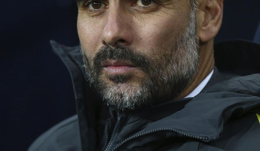 Manchester City manager Pep Guardiola looks out during the English Premier League soccer match between Manchester City and Arsenal at the Etihad Stadium in Manchester, England, Sunday, Dec. 18, 2016. (AP Photo/Dave Thompson)