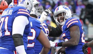 Buffalo Bills running back LeSean McCoy, right, celebrates after scoring on a touchdown run against the Cleveland Browns during the second half of an NFL football game, Sunday, Dec. 18, 2016, in Orchard Park, N.Y. (AP Photo/Bill Wippert)