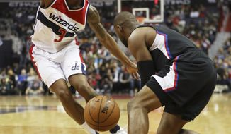 Washington Wizards guard Bradley Beal (3) defends against LA Clippers guard Chris Paul, right, during the first half of an NBA basketball game in Washington, Sunday, Dec. 18, 2016. (AP Photo/Manuel Balce Ceneta)