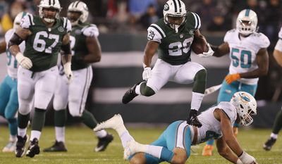 New York Jets running back Bilal Powell (29) leaps over Miami Dolphins middle linebacker Kiko Alonso (47) during the second quarter of an NFL football game, Saturday, Dec. 17, 2016, in East Rutherford, N.J. (AP Photo/Adam Hunger)