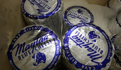 ADVANCE FOR SUNDAY, DEC. 18, 2016- In this undated photo, Maytag Raw Milk Blue Cheese is displayed at Maytag Dairy Farms in Newton, Iowa. Owners of the Maytag Dairy Farms said they have plans to restart production at their Newton cheese plant, which has been shuttered for more than 10 months after a listeria contamination last February.  (Rodney White/The Des Moines Register via AP)