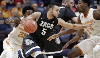 Gonzaga guard Nigel Williams-Goss (5) drives against Tennessee defenders Jordan Bowden (23) and Kyle Alexander (11) in the first half of an NCAA college basketball game Sunday, Dec. 18, 2016, in Nashville, Tenn. (AP Photo/Mark Humphrey)