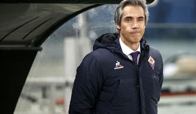 Fiorentina's coach Paulo Sousa gives directions to his players before the Serie A soccer match between Lazio and Fiorentina at Rome's Olympic stadium Sunday, Dec. 18, 2016 (Riccardo Antimiani/ANSA via AP)