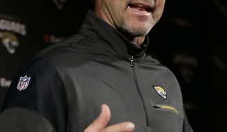 Jacksonville Jaguars head coach Gus Bradley talks to media after falling to the Houston Texans in an NFL football game Sunday, Dec. 18, 2016, in Houston. Bradley was fired after the loss. (AP Photo/David J. Phillip)