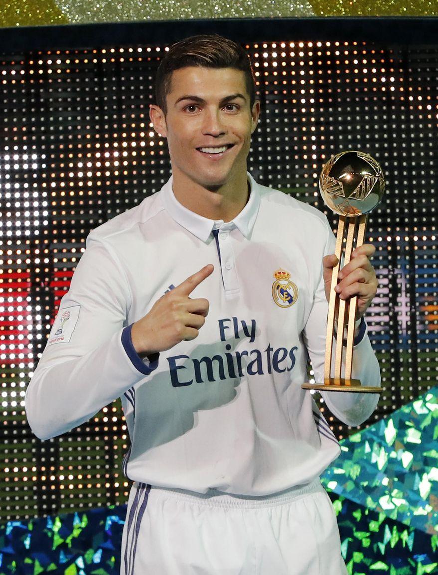 Real Madrid's Cristiano Ronaldo celebrates as he holds the golden ball award for the most goals after winning the final of the FIFA Club World Cup soccer tournament in Yokohama, near Tokyo, Sunday, Dec. 18, 2016.(AP Photo/Shuji Kajiyama)