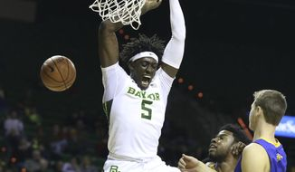 Baylor forward Johnathan Motley, scores over John Brown forward Brenton Toussaint and forward Benjamin Smith, right, in the second half of an NCAA college basketball game, Sunday, Dec. 18, 2016, in Waco, Texas. (Rod Aydelotte/Waco Tribune-Herald via AP)