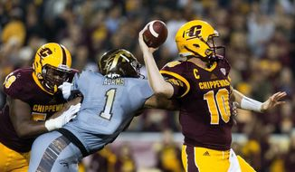 FILE - In this Saturday, Oct. 1, 2016, file photo, Central Michigan quarterback Cooper Rush (10) attempts to throw as Western Michigan defensive end Keion Adams (1) gets a hand on him during the first half of an NCAA college football game in Mount Pleasant, Mich. Central Michigan will play Tulsa in the Miami Beach Bowl on Monday, Dec. 19. (Bryan Bennett/Kalamazoo Gazette-MLive Media Group via AP, File)