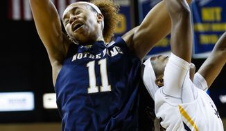 Notre Dame forward Brianna Turner (11) grabs the rebound over Toledo guard Olivia Cunningham (0) in the first half of an NCAA college basketball game, Sunday, Dec. 18, 2016 in Toledo, Ohio. (AP Photo/Rick Osentoski)