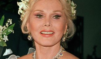 FILE- In an Aug. 15, 1986 file photo, actress Zsa Zsa Gabor is shown Los Angeles. Gabor died Sunday, Dec. 18, 2016, of a heart attack at her Bel-Air home, her husband, Prince Frederic von Anhalt, said. She was 99. (AP Photo/File)