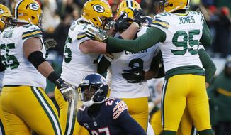 Green Bay Packers kicker Mason Crosby (2) celebrates with his teammates after kicking a game winning field goal against the Chicago Bears during the second half of an NFL football game, Sunday, Dec. 18, 2016, in Chicago. The Packers won 30-27. (AP Photo/Nam Y. Huh)