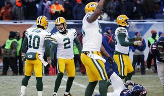 Green Bay Packers kicker Mason Crosby (2) celebrates with teammates after kicking the game winning field goal against the Chicago Bears during the second half of an NFL football game, Sunday, Dec. 18, 2016, in Chicago. The Packers won 30-27. (AP Photo/Charles Rex Arbogast)