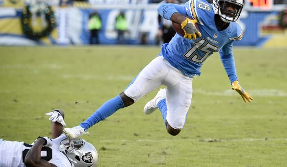 San Diego Chargers wide receiver Dontrelle Inman (15) gets away from Oakland Raiders strong safety T.J. Carrie (38) during the second half of an NFL football game Sunday, Dec. 18, 2016, in San Diego. (AP Photo/Denis Poroy) ** FILE **