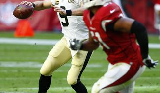 New Orleans Saints quarterback Drew Brees (9) throws against the Arizona Cardinals during the first half of an NFL football game, Sunday, Dec. 18, 2016, in Glendale, Ariz. (AP Photo/Ross D. Franklin)