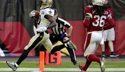 New Orleans Saints wide receiver Brandin Cooks (10) scores a touchdown as Arizona Cardinals free safety D.J. Swearinger (36) defends during the first half of an NFL football game, Sunday, Dec. 18, 2016, in Glendale, Ariz. (AP Photo/Rick Scuteri)