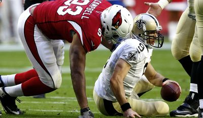 New Orleans Saints quarterback Drew Brees (9) is sacked by Arizona Cardinals defensive end Calais Campbell (93) during the first half of an NFL football game, Sunday, Dec. 18, 2016, in Glendale, Ariz. (AP Photo/Ross D. Franklin)