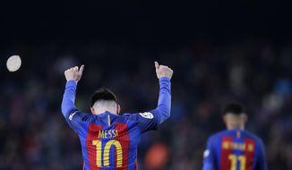 FC Barcelona's Lionel Messi celebrates after scoring during the Spanish La Liga soccer match between FC Barcelona and Espanyol at the Camp Nou in Barcelona, Spain, Sunday, Dec. 18, 2016. (AP Photo/Manu Fernandez)
