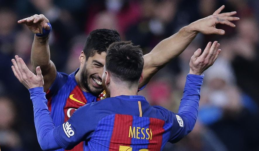 FC Barcelona's Luis Suarez, left, celebrates with his teammate Lionel Messi after scoring during the Spanish La Liga soccer match between FC Barcelona and Espanyol at the Camp Nou in Barcelona, Spain, Sunday, Dec. 18, 2016. (AP Photo/Manu Fernandez)