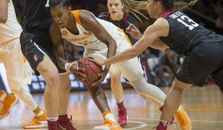Stanford's Marta Sniezek (13) tries to take the ball away from Tennessee's Diamond DeShields (11) during the second half of an NCAA college basketball game, Sunday, Dec. 18, 2016 in Knoxville, Tenn. Tennessee defeated Stanford 59-51. (Brianna Paciorka/Knoxville News Sentinel via AP)