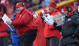 Kansas City Chiefs head coach Andy Reid, left, yells on the sideline during the second half of an NFL football game against the Tennessee Titans in Kansas City, Mo., Sunday, Dec. 18, 2016.  (AP Photo/Ed Zurga)