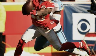 Kansas City Chiefs wide receiver Tyreek Hill (10) cannot reach the ball in front of Tennessee Titans defensive back Bennett Okotcha (23) during the second half of an NFL football game in Kansas City, Mo., Sunday, Dec. 18, 2016. (AP Photo/Ed Zurga)