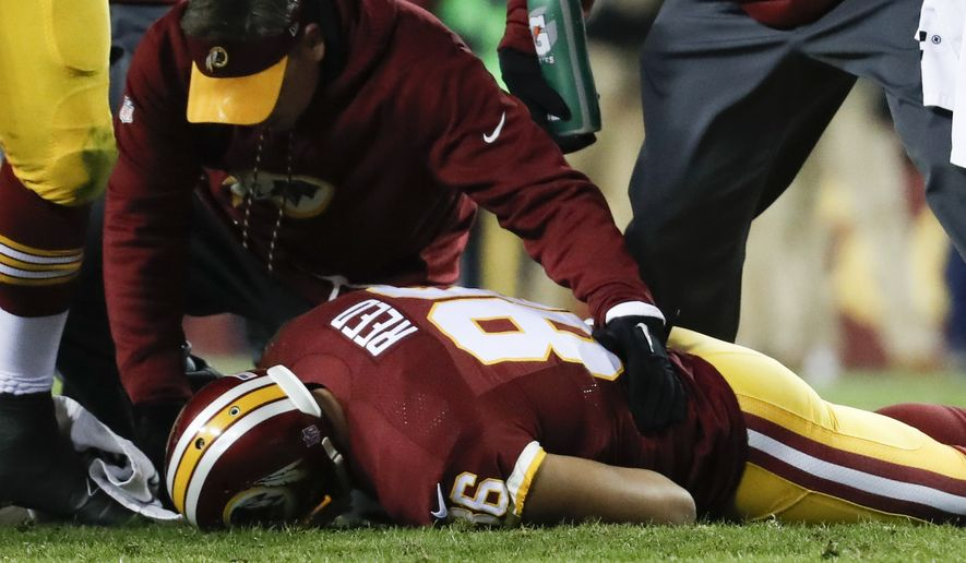 Washington Redskins tight end Jordan Reed (86) lies on the field after an injury during the second half of an NFL football game against the Carolina Panthers in Landover, Md., Monday, Dec. 19, 2016. (AP Photo/Alex Brandon)