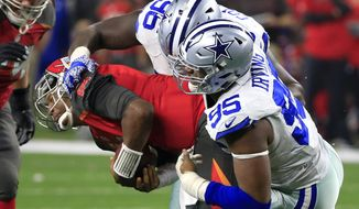 Tampa Bay Buccaneers quarterback Jameis Winston, center, is sacked by Dallas Cowboys' Maliek Collins (96) and David Irving (95) in the final minutes of the second half of an NFL football game, Sunday, Dec. 18, 2016, in Arlington, Texas. (AP Photo/Ron Jenkins)