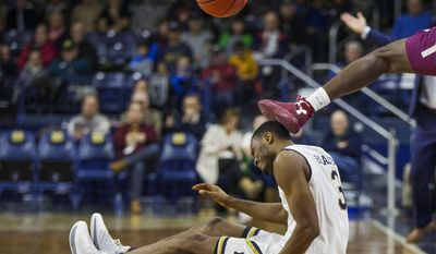 Notre Dame's V.J. Beachem (3) gets kicked in the head while competing for a loose ball with Colgate's Jordan Swopshire during the second half of an NCAA college basketball game Monday, Dec. 19, 2016, in South Bend, Ind. (AP Photo/Robert Franklin)