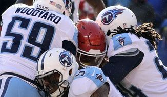 Tennessee Titans linebacker Wesley Woodyard (59), linebacker Avery Williamson, center bottom, and safety Daimion Stafford (24) prevent Kansas City Chiefs running back Spencer Ware, center, from crossing the goal line, during the first half of an NFL football game in Kansas City, Mo., Sunday, Dec. 18, 2016. (AP Photo/Charlie Riedel)