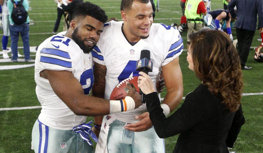 fddcb149f58 Dallas Cowboys' Ezekiel Elliott (21) leans his head on quarterback Dak  Prescott (4) as the duo give a post game interview to Michele Tafoya,  right, ...