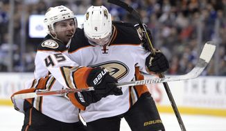 Anaheim Ducks defenceman Cam Fowler (4) celebrates his power play goal with teammate defenceman Sami Vatanen (45) during the third period of an NHL hockey game in Toronto, Monday, Dec. 19, 2016. (Nathan Denette/The Canadian Press via AP)