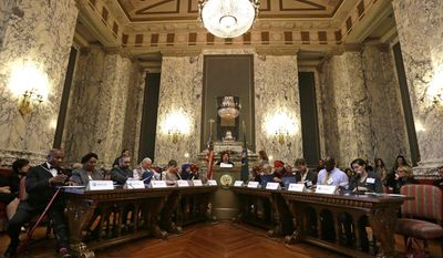 Electors fill out their ballots during a meeting of Washington state's Electoral College, Monday, Dec. 19, 2016, in Olympia, Wash. (AP Photo/Elaine Thompson)