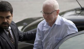 FILE - This is a Tuesday, Sept. 6, 2016, file photo of the head of Ireland's Olympic Committee  Patrick Hickey as he arrives to a police station in Rio de Janeiro, Brazil. Hickey arrived back in Ireland, Sunday Dec. 18, 2016, four months after being arrested in Brazil during the Rio de Janeiro Games on ticket scalping charges. (AP Photo/Mauro Pimentel, File)