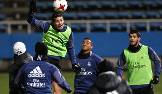 Real Madrid's James Rodriguez, left top, heads the ball during a training session at the FIFA Club World Cup soccer tournament in Yokohama, near Tokyo, Friday, Dec. 16, 2016. Real Madrid and Kashima Antlers will play in the Dec. 18 final. (AP Photo/Shuji Kajiyama)