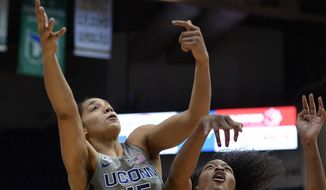 Connecticut's Gabby Williams, left, and Ohio State's Stephanie Mavunga vie for a rebound in the first half of an NCAA college basketball game, Monday, Dec. 19, 2016, in Hartford, Conn. (AP Photo/Jessica Hill)