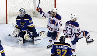 Edmonton Oilers' Ryan Nugent-Hopkins (93) celebrates along side teammate Andrej Sekera, of Slovakia, after scoring past St. Louis Blues goalie Carter Hutton (40) and Blues' Alex Pietrangelo (27) during overtime of an NHL hockey game Monday, Dec. 19, 2016, in St. Louis. The Oilers won 3-2 in overtime. (AP Photo/Jeff Roberson)