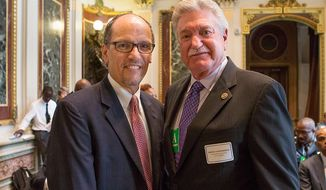 U.S. Secretary of Labor Tom Perez, left, with Harold Schaitberger of the International Association of Fire Fighters in this July 15, 2015 photo via the Labor Department. On Dec. 19, 2016, Mr. Schaitberger announced that the IAFF was endorsing Mr. Perez's bid to head up the Democratic National Committee. [PHOTO: https://blog.dol.gov/2015/07/15/promoting-diversity-among-first-responders/]