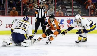 Philadelphia Flyers' Taylor Leier (58) tries to get a shot past Nashville Predators' Pekka Rinne (35) as Adam Pardy (5) defends during the second period of an NHL hockey game, Monday, Dec. 19, 2016, in Philadelphia. (AP Photo/Matt Slocum)