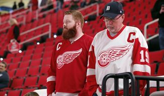 Detroit Red Wings fans look out over the ice following the cancellation of the Red Wings game with the Carolina Hurricanes due to a problem with the ice in the PNC Arena, Monday, Dec. 19, 2016, in Raleigh, N.C. Game will be rescheduled. (AP Photo/Karl B DeBlaker)