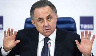 FILE - In this Dec. 25, 2015 file photo Russian Sports Minister Vitaly Mutko gestures during a news conference in Moscow, Russia. Players from Russia's under-21 national soccer team had suspicious drug-test samples covered up, emails released by a World Anti-Doping Agency investigation show. Another case in the Russian league was allegedly covered up by then-Sports Minister Vitaly Mutko, who is also in charge of the country's World Cup preparations. (AP Photo/Pavel Golovkin, File)